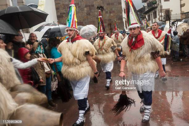 People dressed up as Bellringer Joaldunak in Basque perform during the celebration of an ancient traditional carnival on January 29 2019 in Zubieta...