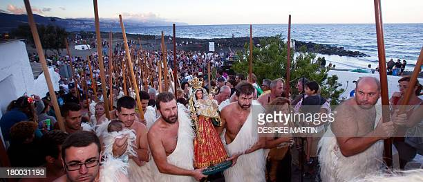 People dressed up as 'Guanches' the aboriginal Berber inhabitants of the Canary Islands perform the apparition of the Virgin del Socorro to natives...