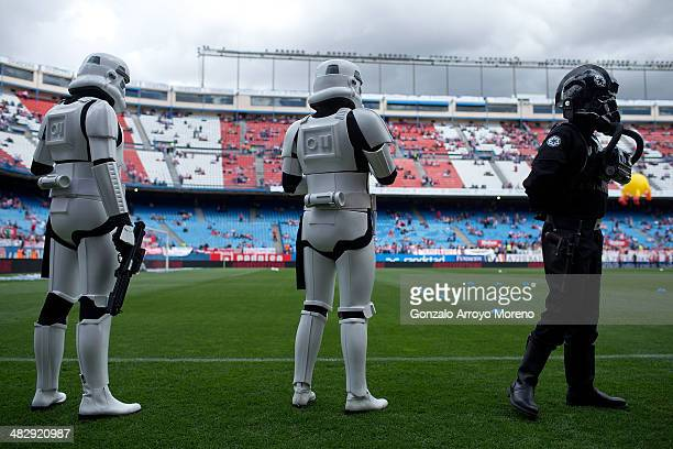 People dressed up as Imperial soldiers of Star Wars film walks on the pitch prior to start the La Liga match between Club Atletico de Madrid and...