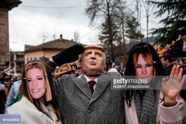 People dressed up as Ivanka Trump US President Donald Trump and US first lady Melania Trump take part in a carnival through the southwestern...