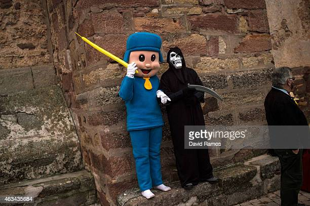People dressed up as Pocoyo and Scream join a carnival festival on February 14 2015 in Luzon Spain Every year Luzon hosts one of the leastknown...