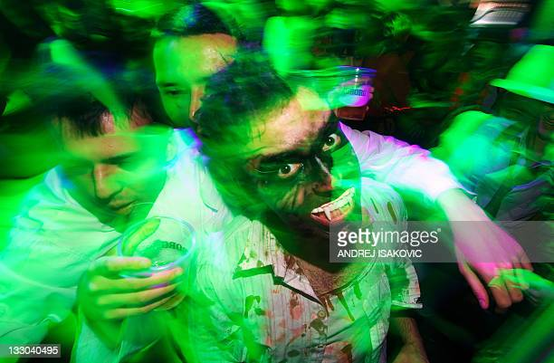 People dressed up as zombies during a Halloween Eve Party in Belgrade on October 30 2011 Halloween is based on the Celtic festival of Samhain and the...