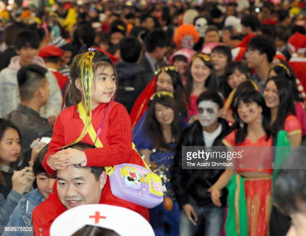 People dressed up costumes on the Halloween night in Shibuya district on October 31 2017 in Tokyo Japan
