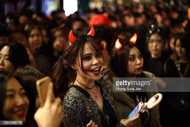 People dressed up in costumes participate a Halloween festival on October 27 2018 in Seoul South Korea Halloween which is named from All Hallows'...