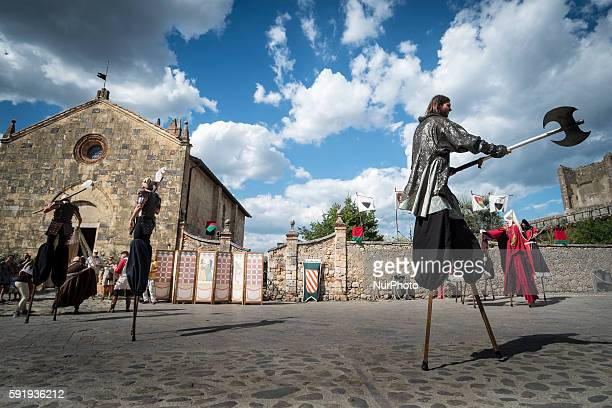 People dressed up in historical costumes at the 26th edition of the Medieval fair at Monteriggioni Tuscany Italia on 17 July 2016 Every year the...