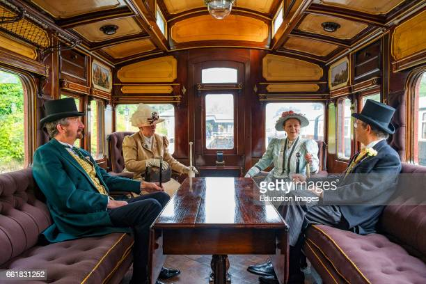 People dressed up in Victorian clothing to celebrate the Victorians input to the age of steam trains Bodmin Cornwall UK