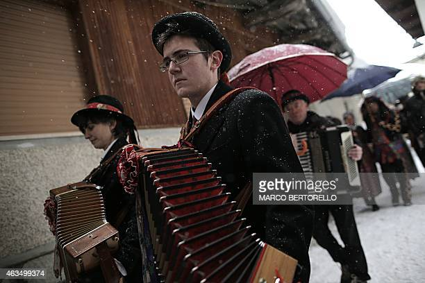 People dressed with traditional clothes take part in the 'Beo de Blins' carnival on February 15 2015 in the Alps region of Bellino South Piedmont...