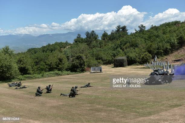 People dressed with uniforms of World War II and armed take part in a ceremony called Roupel 1941 The Revival organized by the municipality of...
