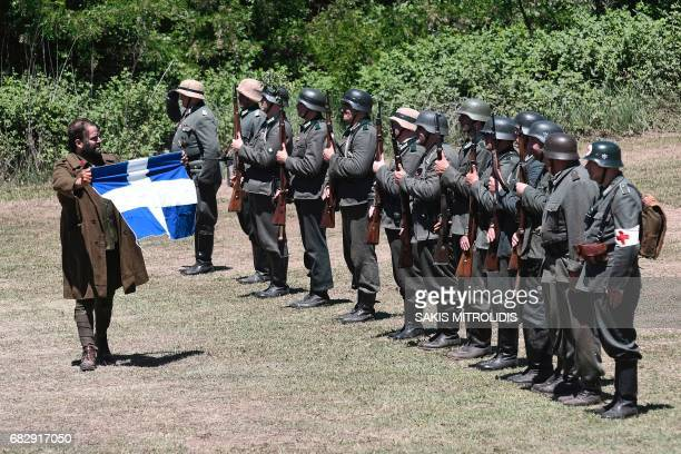 People dressed with World War II uniforms take part in a ceremony called Roupel 1941 The Revival organized by the municipality of Sintiki for the...