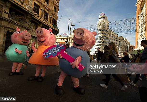 People dressedup as Peppa La Cerdita a well known Spanish children's animation television programme advertise 'Black Friday' discounts for their...