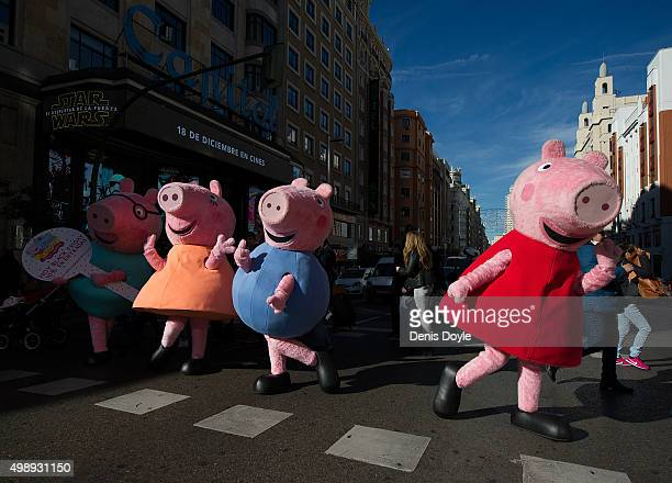 People dressedup as 'Peppa La Cerdita' a well known Spanish children's animation television programme advertise 'Black Friday' discounts for their...