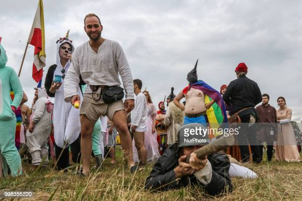 People dresses as a Gay pride participants are seen in Grunwald Poland on 13 July 2018 Battle of Grunwald reenactment participants take part in the...