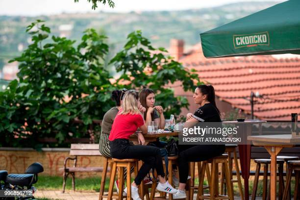 People drink a coffee in the city of Veles on June 12 2018