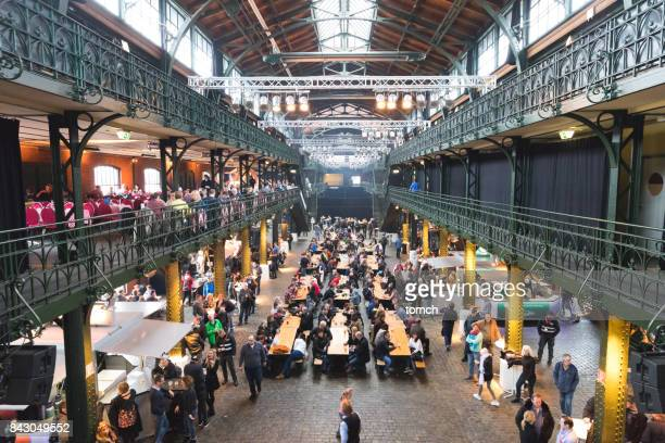 People drink and dance in the indoor fish market in Hamburg.