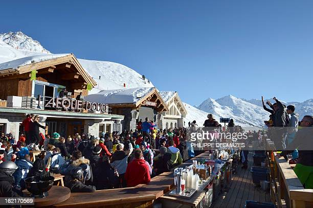People drink and dance on an outdoor dance floor as artists perform at the La Folie Douce on February 19 2013 in Méribel French Alps La Folie Douce...