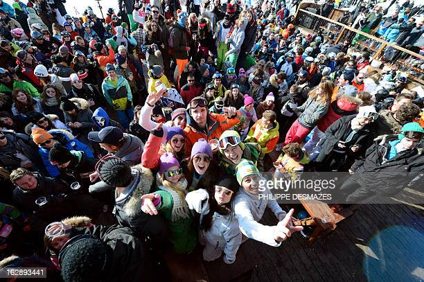 People drink and dance on an outdoor dance floor at the 'La Folie Douce' on February 28 2013 in Val Thorens French Alps 'La Folie Douce' is an...