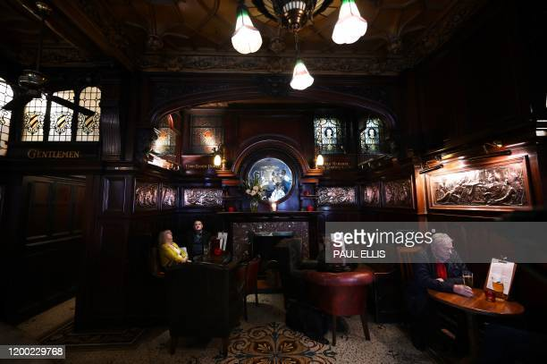 People drink at The Philharmonic Dining Rooms pub in Liverpool north west England on February 11 2020 Liverpool drinking institution The Phil a...