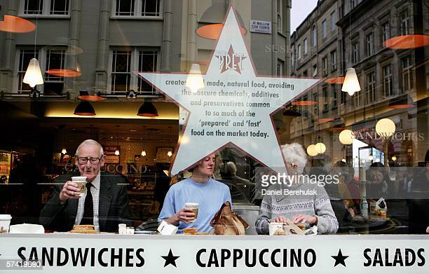 People drink coffee at a Pret A Manger store in central London on April 25, 2006 in London, England. The all traditional English style Breakfast...