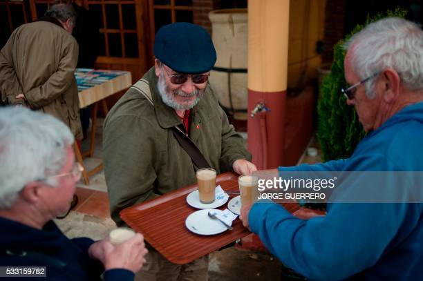 People drink coffee in the English market in Mollina on March 16 2015 Of all UKborn residents living in the EU in 2011 the largest number was in...