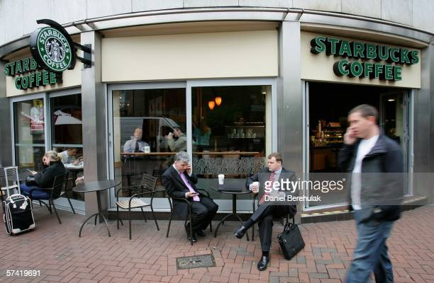 People drink coffee outside a Starbucks store in central London on April 25, 2006 in London, England. The all traditional English style Breakfast...
