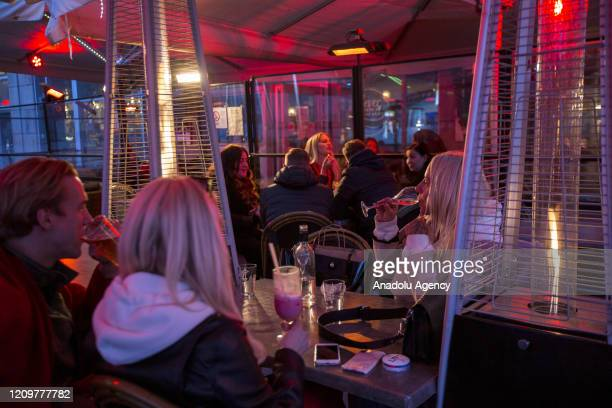 People drink in a restaurant in central Stockholm amid the new coronavirus pandemic in Stockholm Sweden April 11 2020 Swedish authorities have...