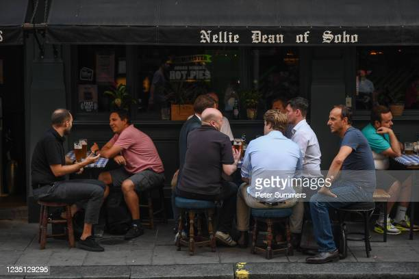 People drink outside a pub in Soho on September 8, 2021 in London, England. A recent survey by a recruitment firm showed that 25 per cent of London...