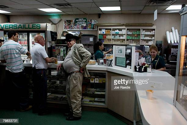 People drink their morning coffee at the Versailles restaurant in the Little Havana neighborhood February 19, 2007 in Miami, Florida. Cuban leader...