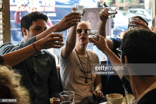 People drink while watching testimony from former FBI Director James Comey during a Senate Intelligence Committee hearing on Russian interference in...