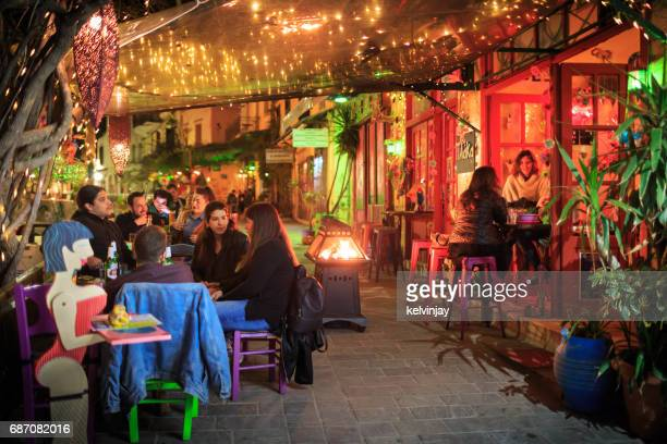 People drinking and eating out on a night in Chania, Crete