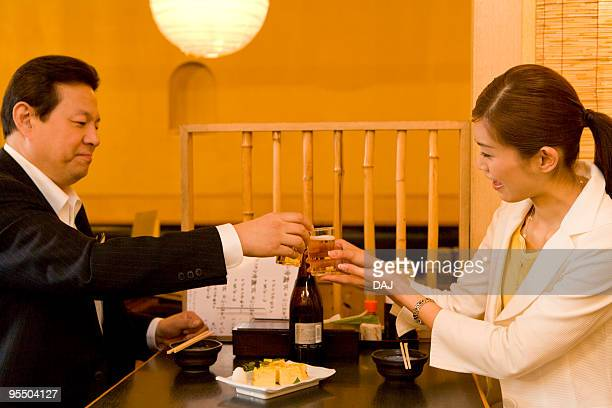 People Drinking at Izakaya