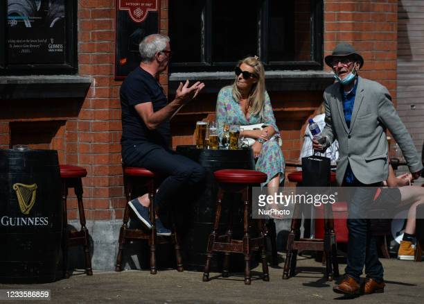 People drinking beer outside a pub in Dublin city center. On Monday, 21 June 2021, in Dublin, Ireland.