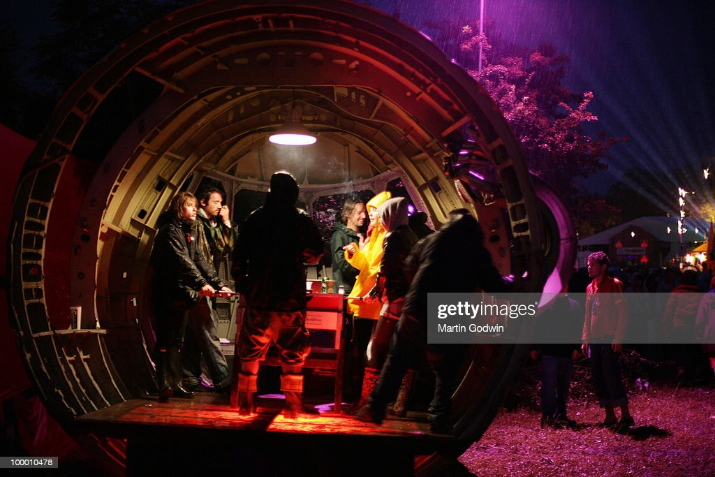 People drinking in a plane's nose cone on Thursday night in the Shangri-La area of Glastonbury, 26th June 2008.
