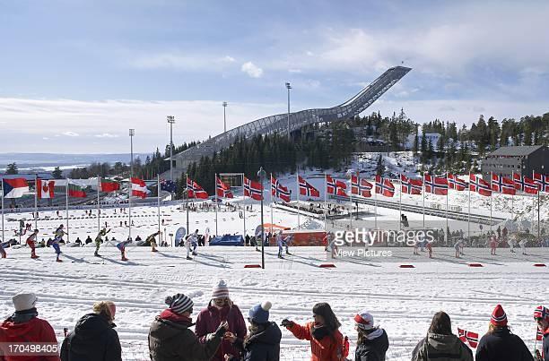 People drinking in foreground with jump behind Holmenkollen Ski Jump Ski Jump Europe Norway JDS Architects