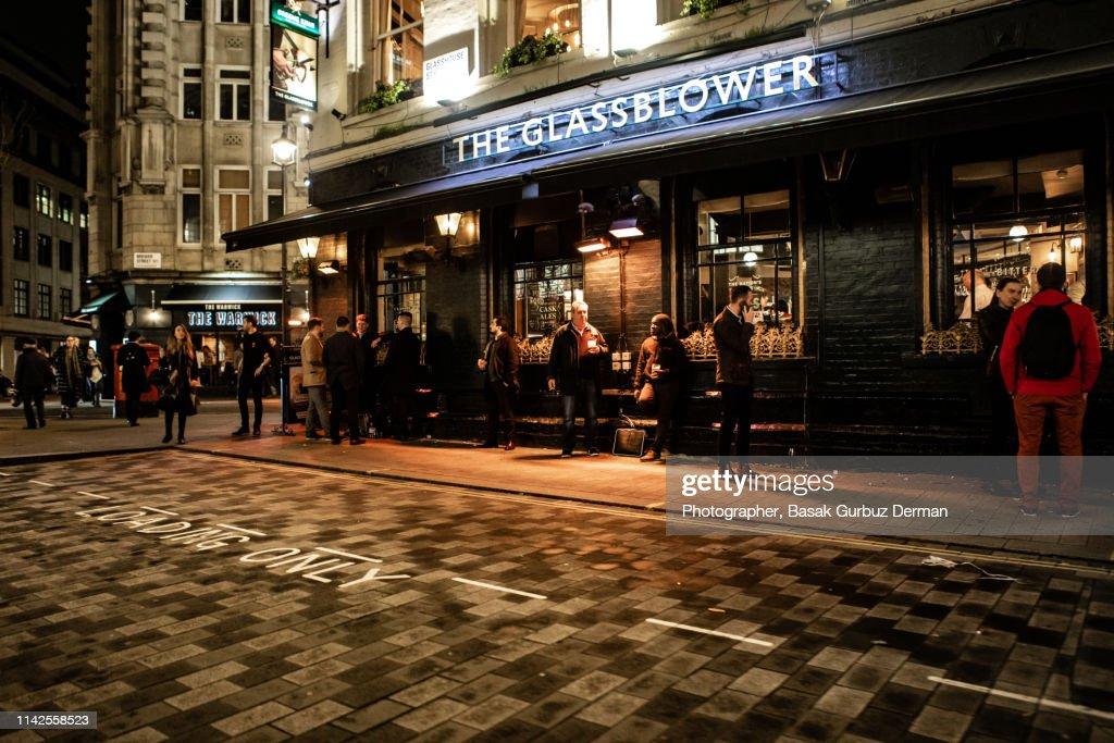 People drinking outside the Glassblower pub, Soho : Stock Photo