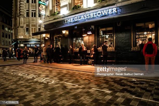 People drinking outside the Glassblower pub, Soho