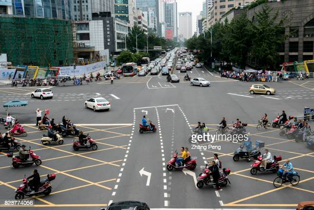People drive ebikes past a crossroad There are more than 250 million electric bicycles driving in China As the market demand tends to saturate and...