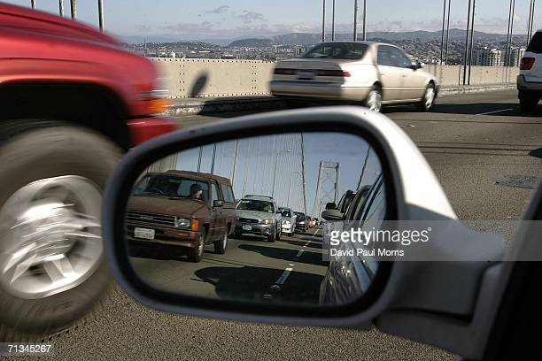 People drive over the Bay Bridge into San Francisco at the beginning of the 4th of July holiday weekend on June 30, 2006 in San Francisco,...