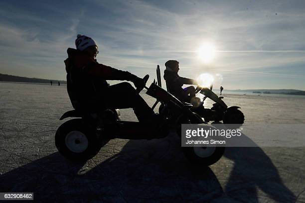 People drive over the ice on Lake Ammersee on January 28 2017 in Stegen am Ammersee Germany After an unusual cold winter period currently most of the...