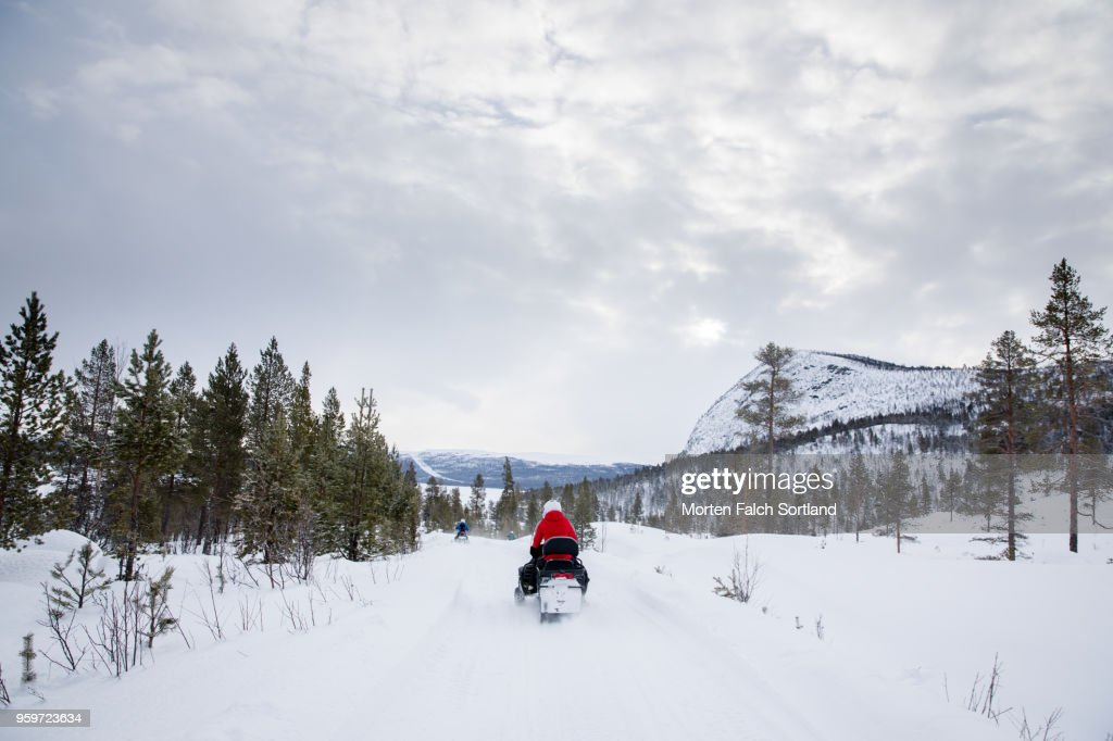 People Drive Snowmobiles on a Mountain in Rural Norway, Wintertime : Stock Photo