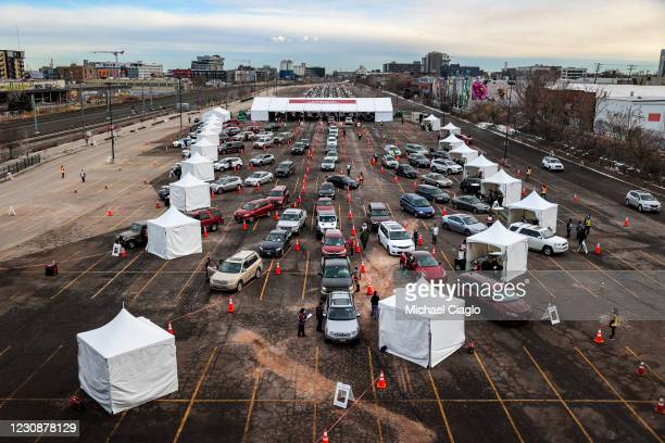 People drive their cars to medical tents at a mass COVID-19 vaccination event on January 30, 2021 in Denver, Colorado. UCHealth, Colorado's largest...