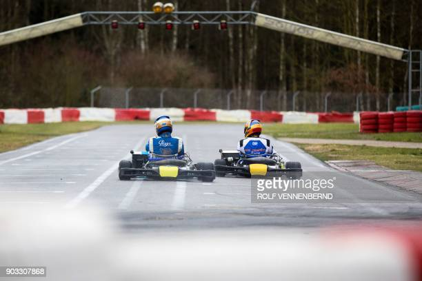 People drive their go karts on January 10 2018 at the karting circuit in Kerpen located 30 kilometres from Cologne in western Germany The gokarting...