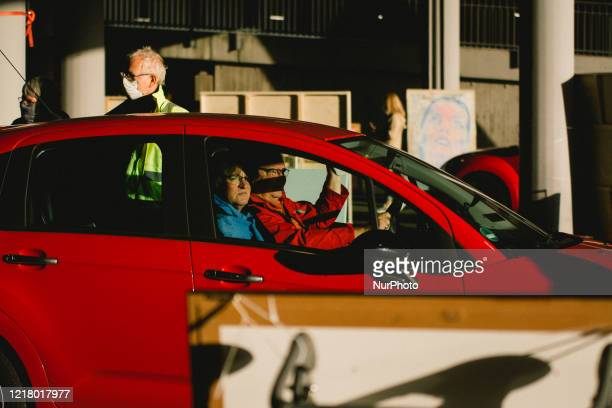 people drive through the show through the parking lot during the opening of drive in Gallery's show Nachtbroetchen 20 at Cologne airport parking lot...