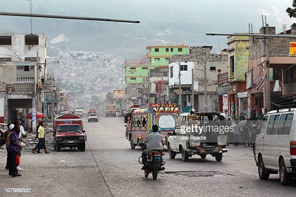 People drive through the streets almost one year to the date of the massive earthquake that jolted the city on January 09 2011 in PortauPrince Haiti...