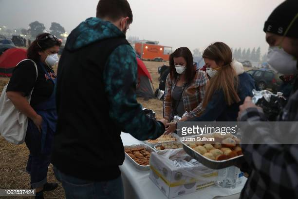 People drop off freshly baked cookies and cupcakes to Camp Fire evacuees who are living in a Walmart parking on November 16 2018 in Chico California...
