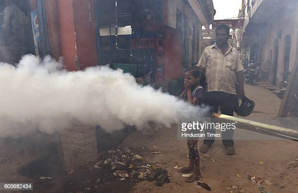 People during a fumigation drive organized by Delhi Water Minister Kapil Mishra and BJP MP Manoj Tiwari at Sonia Vihar to protect residents from...