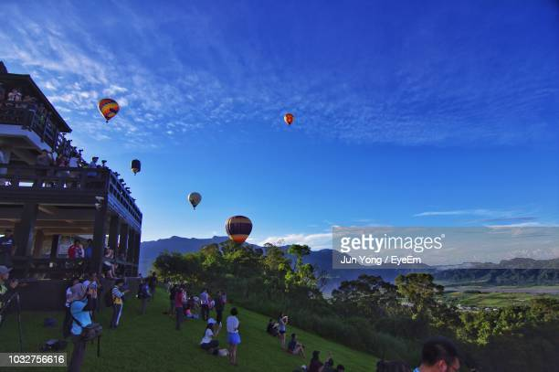 people during ballooning festival - balloon fiesta stock pictures, royalty-free photos & images