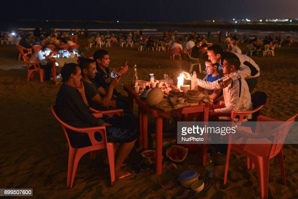 People during Iftar a meal after the sunset consumed on Rabat beach in Rabat Morocco on June 21 2017 Laylat alQadr or Night of Destiny which falls on...