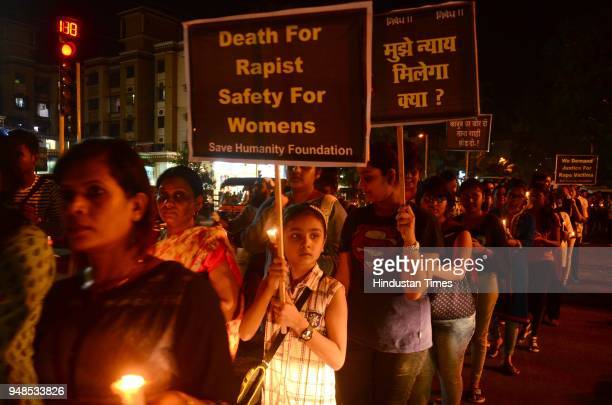People during the candle light march to demand justice for Kathua and Unnao rape case victims organised by various social originations at RF Naik...