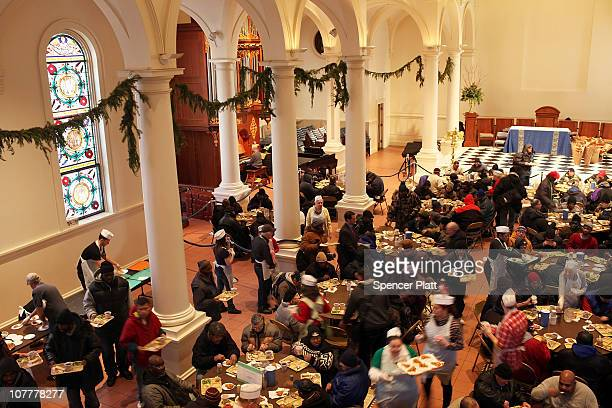 People eat a Christmas holiday meal at the Holy Apostles Soup Kitchen on December 24, 2010 in New York City. The soup kitchen on Manhattan West side...
