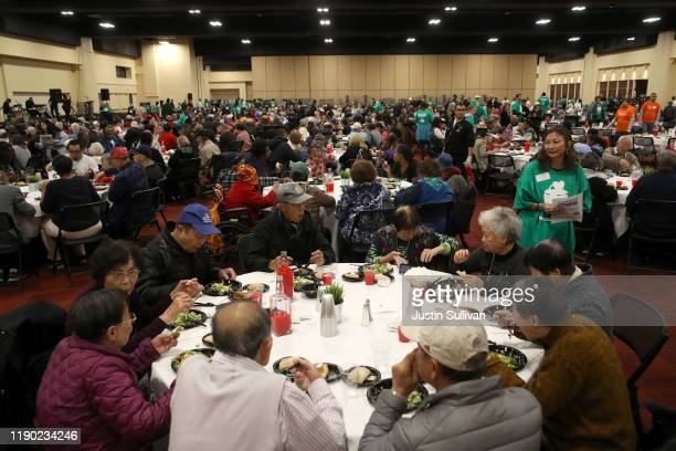 People eat a free Thanksgiving meal during the City of Oakland's 28th Annual Thanksgiving Dinner on November 26, 2019 in Oakland, California. The...
